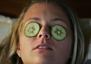 Facial with cucumber slices