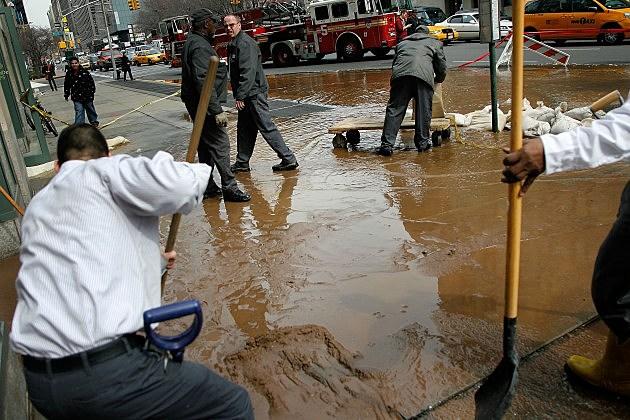 Water Main Break Floods Portion Of Varick Street In New York