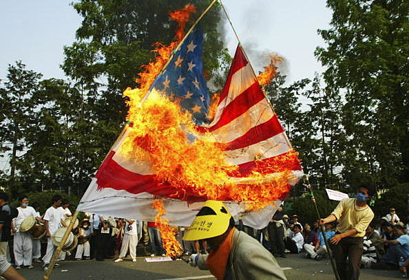 flag burning should be outlawed in america Transcript of should flag burning as a form of protest be prohibited burning the united states flag is considered to be why flag burning should be banned.