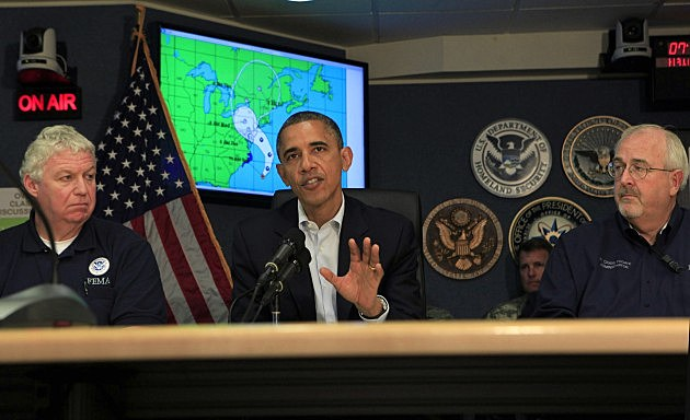 U.S. President Barack Obama makes a statement after a briefing on Hurricane Sandy with Richard Serino (L), Deputy Administrator, FEMA, and Craig Fugate (R), Administrator FEMA