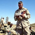 U.S. Army 101st Airborne Division SPC Jason Boudreaux from Odessa, Texas reads a card