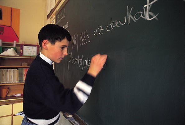 Ikastola (Basque school) A pupil writes in the blackboard of an ikastola
